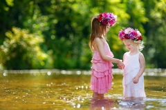 Two little sisters wearing flowers crowns Stock Photo