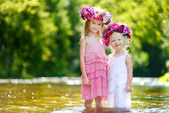 Two little sisters wearing flowers crowns Royalty Free Stock Image