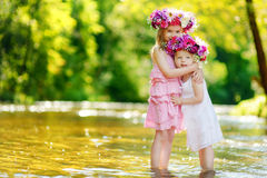 Two little sisters wearing flowers crowns Royalty Free Stock Photo