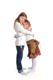 Two little sisters on a white Royalty Free Stock Photos