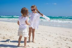 Two little sisters in white clothes have fun at Stock Photo