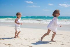 Two little sisters in white clothes have fun at Stock Images