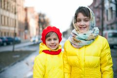 Two little sisters in   winter city. Little girls   walking outside in  autumn royalty free stock photography
