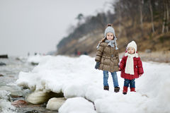 Two little sisters on a winter day Royalty Free Stock Photography