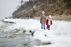 Two little sisters on a winter day Royalty Free Stock Photo
