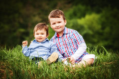 Two little smiling child boy brothers walking. Outdoor Stock Images