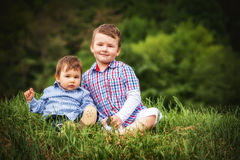 Two little smiling child boy brothers walking Royalty Free Stock Photography