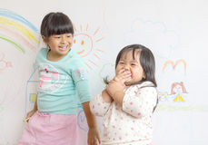 two little smiling children in the draw on the wall stock photos