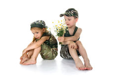 Two little soldiers with the flowers Royalty Free Stock Photos