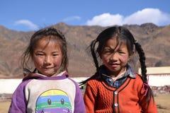 Two little tibetan girls in a school Stock Photography