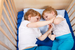 Two little toddler boys having fun and fighting Royalty Free Stock Photos