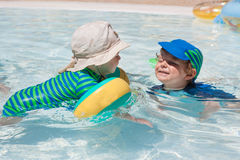 Two little toddlers playing in the pool Royalty Free Stock Image