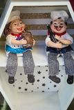 Two toys of cooks sitting on the shelf stock images