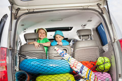Two little travelers ready for summer vacation Stock Image