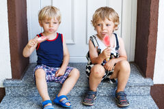 Two little twins boys eating ice cream Stock Image