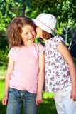 Two little whispering girls Stock Photography