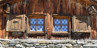 Free Two Little Window On A Facade Of A Mountain Chalet Royalty Free Stock Photo - 148324025