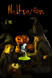 Two little witch cooks a magic potion on Halloween Royalty Free Stock Photography