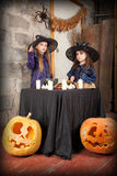 Two little witches Royalty Free Stock Photos