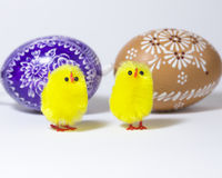 Two little yellow chicks with Easter eggs Royalty Free Stock Images