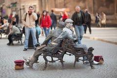 Two live statues. Lviv, Ukraine - march 17: Two live statues sit on benches on March 17, 2012 in Lviv, Ukraine Stock Images
