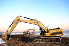 Two loader excavators in open cast in winter Stock Images