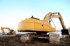 Two loader excavators in open cast in winter royalty free stock photography