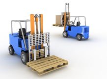 Two loaders with cargo Royalty Free Stock Photos