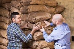 Two loaders handling sacks Stock Photography