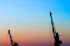 Two loading cranes Stock Photography