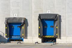 Two loading docks. Two blue loading docks of different height Stock Photo