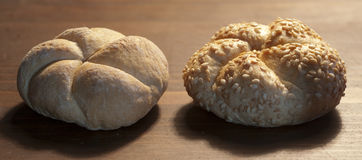 Two loaves. Two little loaves on wooden table stock image