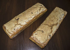 Two loaves of bread baked at home. Polish cuisine. Bread from rye with additives on a dark background royalty free stock photography