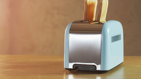 Two Loaves of Bread Jumping Out of an Electric Toaster. Close shot. Shot on RED Epic stock footage