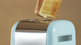 Two Loaves of Bread Jumping Out of an Electric Toaster. Close shot. Shot on RED Epic stock video