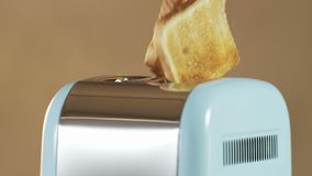 Two Loaves of Bread Jumping Out of an Electric Toaster. Close shot. Shot on RED Epic stock video footage