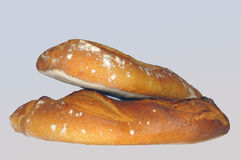 Two loaves of French bread isolated on white. The basic food of the French for which they made a revolution. Loaves of bread royalty free stock photo