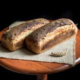 Two loaves of sandwich bread. Two loaves of fresh sandwich bread well baked royalty free stock image