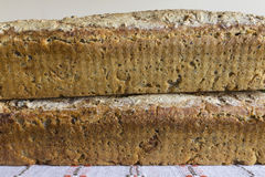 Two loaves of homemade bread. Polish cuisine. Brown bread of rye on a linen napkin with folk embroidery stock photo