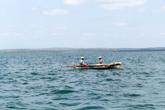 Two local fishermen in a small wooden boat in the Indian Ocean, Tanzania Royalty Free Stock Images