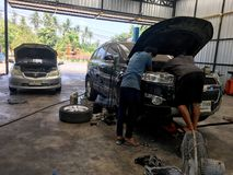 Two local mechanics are trying to fix Checrolet SUV car in Bangkok Thailand April 10, 2018 royalty free stock photos