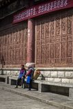 Two local women chatting in street, China royalty free stock image