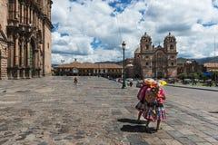 Two local women in Cusco, Peru. Two local women wearing traditional cloths walking in the Plaza de Armas, in Cusco, Peru, 2013 Stock Photos