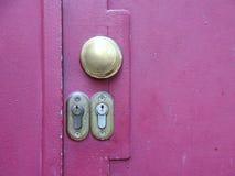Two Lock Keyholes on Purple Metal Door Royalty Free Stock Photography