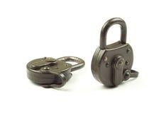 Two locked padlocks on a white background Stock Photos