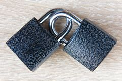 Two locks with bows are linked together. Closeup royalty free stock images