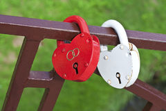 Two locks in the form of hearts Stock Photos