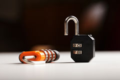 Two locks on white surface Stock Images