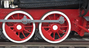 Locomotive wheels. Painted in red color Stock Photography