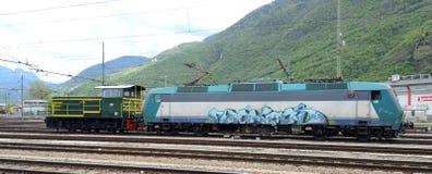 Two locomotives. Electric Locomotive E405 Bombardier and Trenitalia old shunting diesel locomotive Stock Image